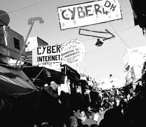 Narrow market street with cyber signs