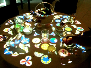 table with cups, glasses and jugs and digital projection