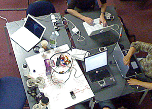 Plan view of a table with three laptops