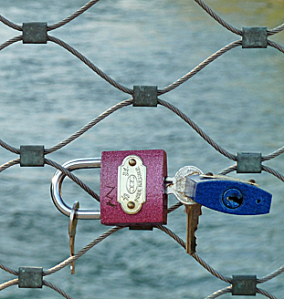 Padlocks and keys secured to bridge railings in Graz