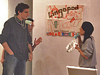 three people simulating communication via tin cans and string