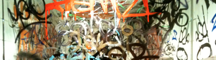 Graffiti sprayed on a bathroom mirror