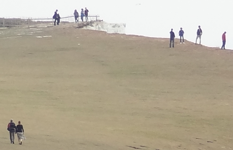 People silhouetted on cliff top