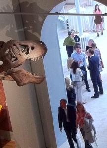 Interior archway, people, dinosaur skeleton