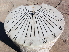 Oblique view of the face of a marble sundial