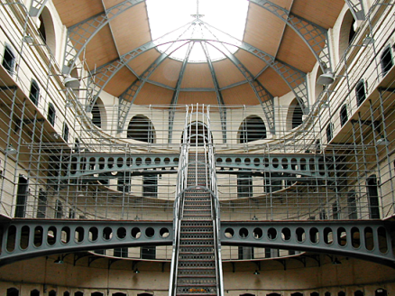 Interior of prison atrium, steel stairs and walkways, roof light