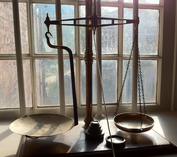 Antique scales on window ledge