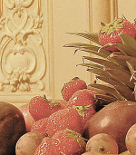 Bowl of fruit with baroque plasterwork behind