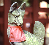 Statue of a fox with a red bib