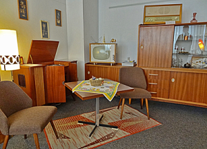 1960s furniture with tv in the corner of the room