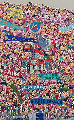 Colourful wall painting with lots of people, slogans and some buildings