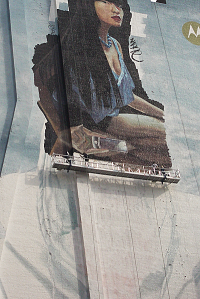 Motorola advertisement with painters on suspended gantry