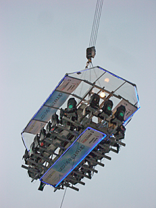 Food counter with patrons suspended in the air from a crane