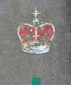 Peeling image of a crown on a grey rendered surface