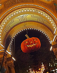 Artificial pumpkin in colourful, illuminated archway