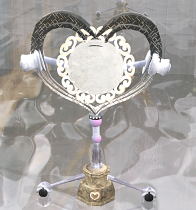 Heart-shaped girly mirror