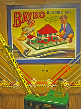 Box lid showing children playing with a toy house