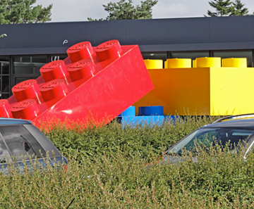 Giant red, yellow and blue Lego blocks ... bigger than a car