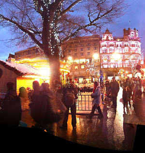Night scene, festive lights, silhouettes of people