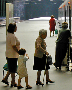 Porto Station: Mother, small child, and old lady with stick boarding a train