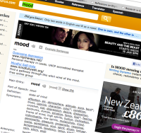 Screen snapshot, at an angle. The word looked up is 'mood'. There's an add promoting New Zealand, and a film ad.