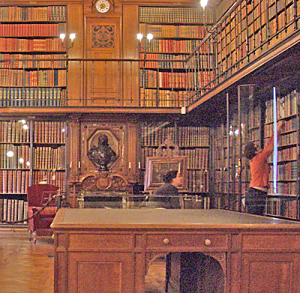 Old style library with a couple of people browsing