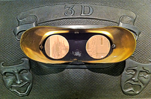 Two lenses for the eyes, happy and sad masks pressed into metal surround, says 3D above