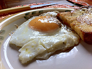 Fried egg on a plate with fried bread