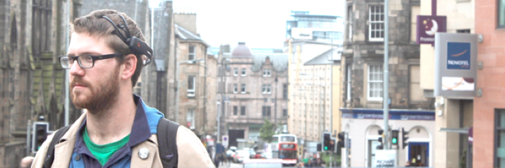 Head and shoulder photograph, head mounted device, and Edinburgh in the background