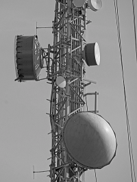 Close up of higher reaches of tower, with cables and disks