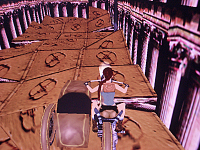 Lara on motocycle in a space with classical columns