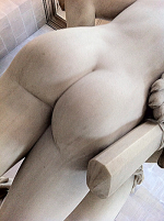Just the buttocks showing, in white marble