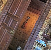 Door ajar, dark image, camera at an angle