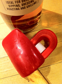 Spatula and freezer clip made into a red heart shape with olive oil bottle.