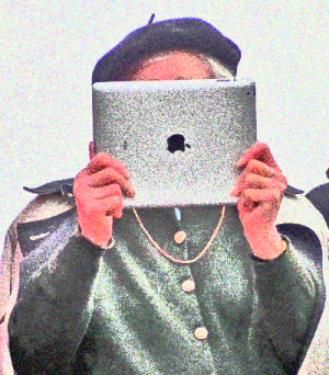 Woman with beret holding iPad at eye level and facing camera