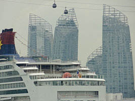 Cruise ship in foreground and with cable car above