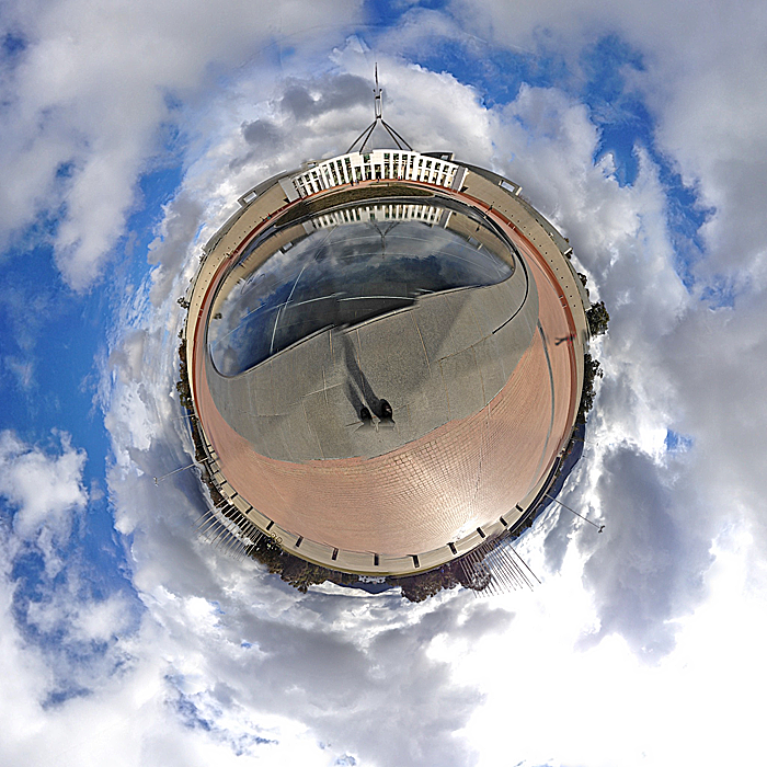 360 degree view, showing lots of clouds. The ground looks spherical. Flag pole is at the top.