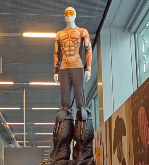 Life-size male mannequin wearing a costume as if a manga superhero