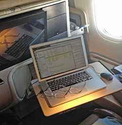 Seat on plane with table and laptop