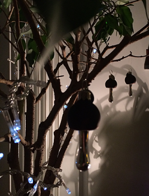 Indoor ficus plan with lights and ornaments