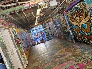 graffiti lined passageway