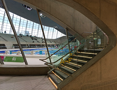 Olympic Aquatic Centre, March 2014. Interior staircase with pool behind